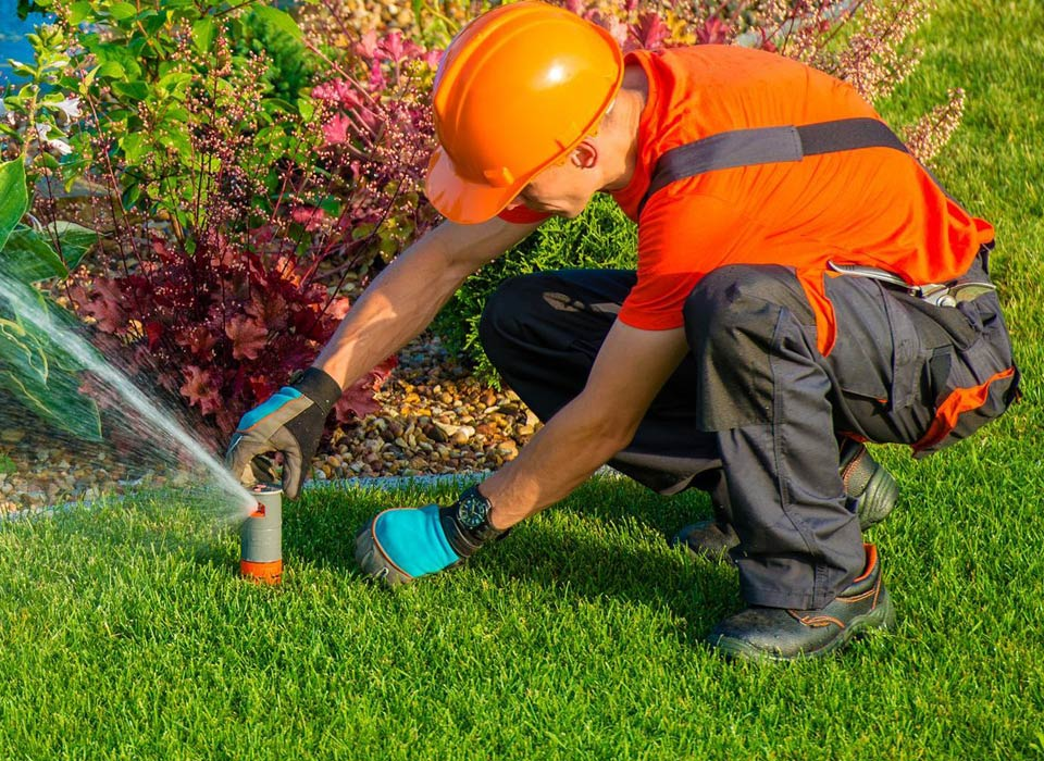 repairing a pop up sprinkler head in northern Los Angeles