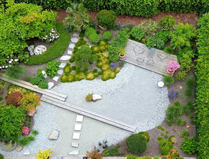 Pasadena landscaping installation with hardscape, xeriscaping, flowers, shrubs, and walkway.