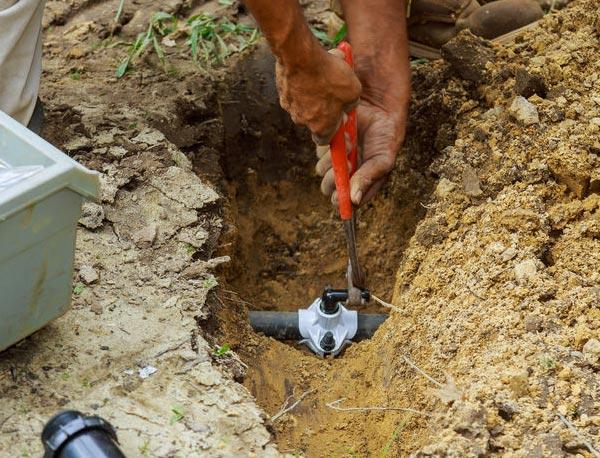 Jack is working on a sprinkler repair in Woodland Hills