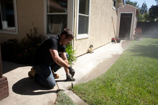 Irrigation contractor repairs a bad pop up sprinkler head in Reseda